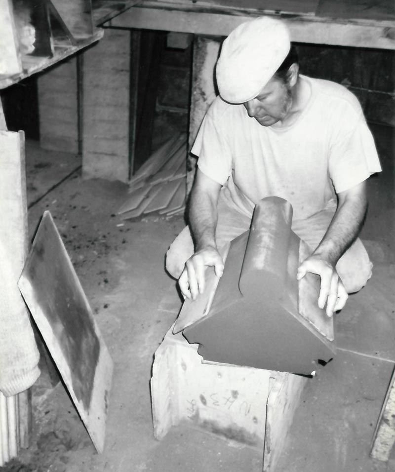 black and white image of Coleford employee making large special shaped bricks