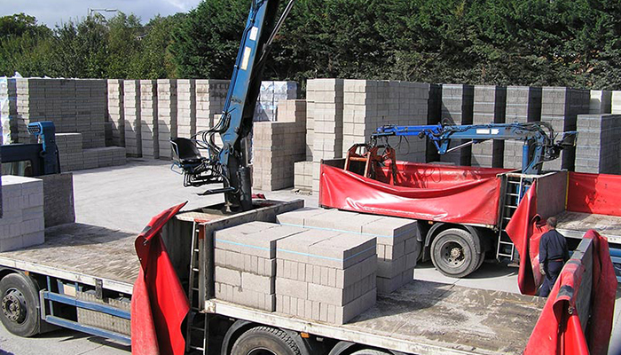 Concrete blocks being loaded on to a lorry