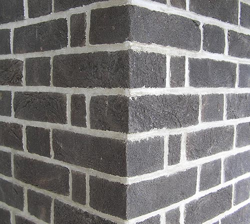 close up of brick slips being used on a wall